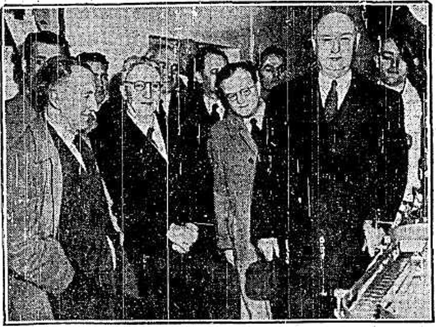 Mr. Jim Farley setting the machinery in motion at the Cork Coca Cola factory, 9 May 1952; Left are the Mayor of Waterford Ald. T. Lynch and the Lord Mayor of Cork, Ald. W. Furlong (picture: Irish Independent)