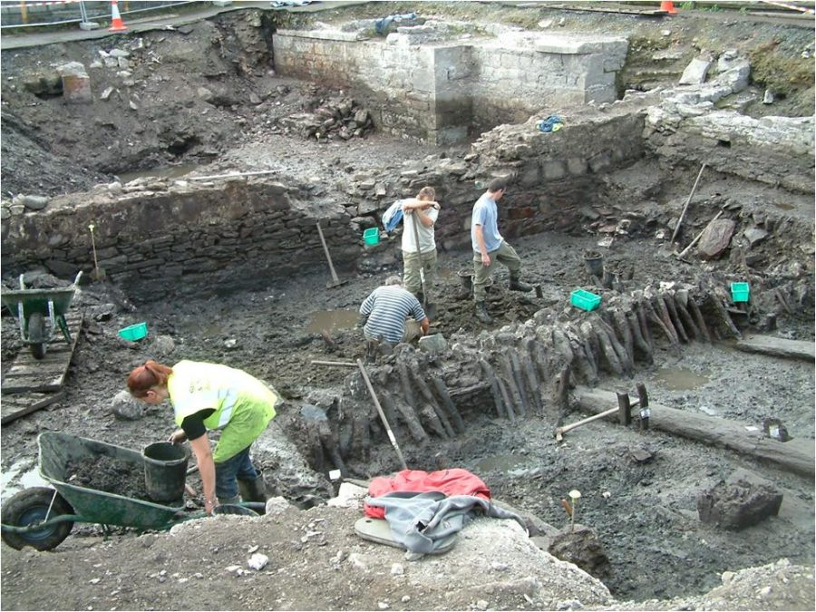 Archaeologists from Sheila Lane & Associates digging at the Grand Parade City Car Park, October 2003; the town wall is at the centre of the photograph; the view is from the interior of the walled town (picture: Kieran McCarthy)