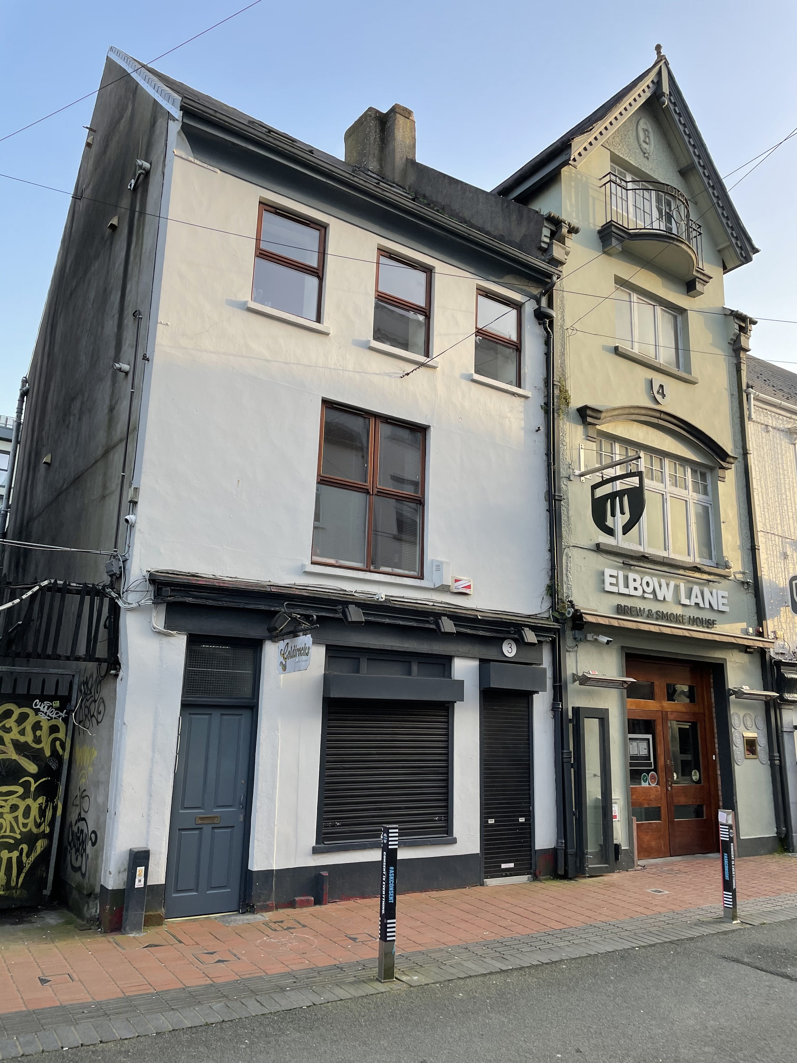 On the left, End-of-terrace three-bay by three-storey former house, built c. 1780,Oliver Plunkett Street, Cork, present day (picture: Kieran McCarthy)