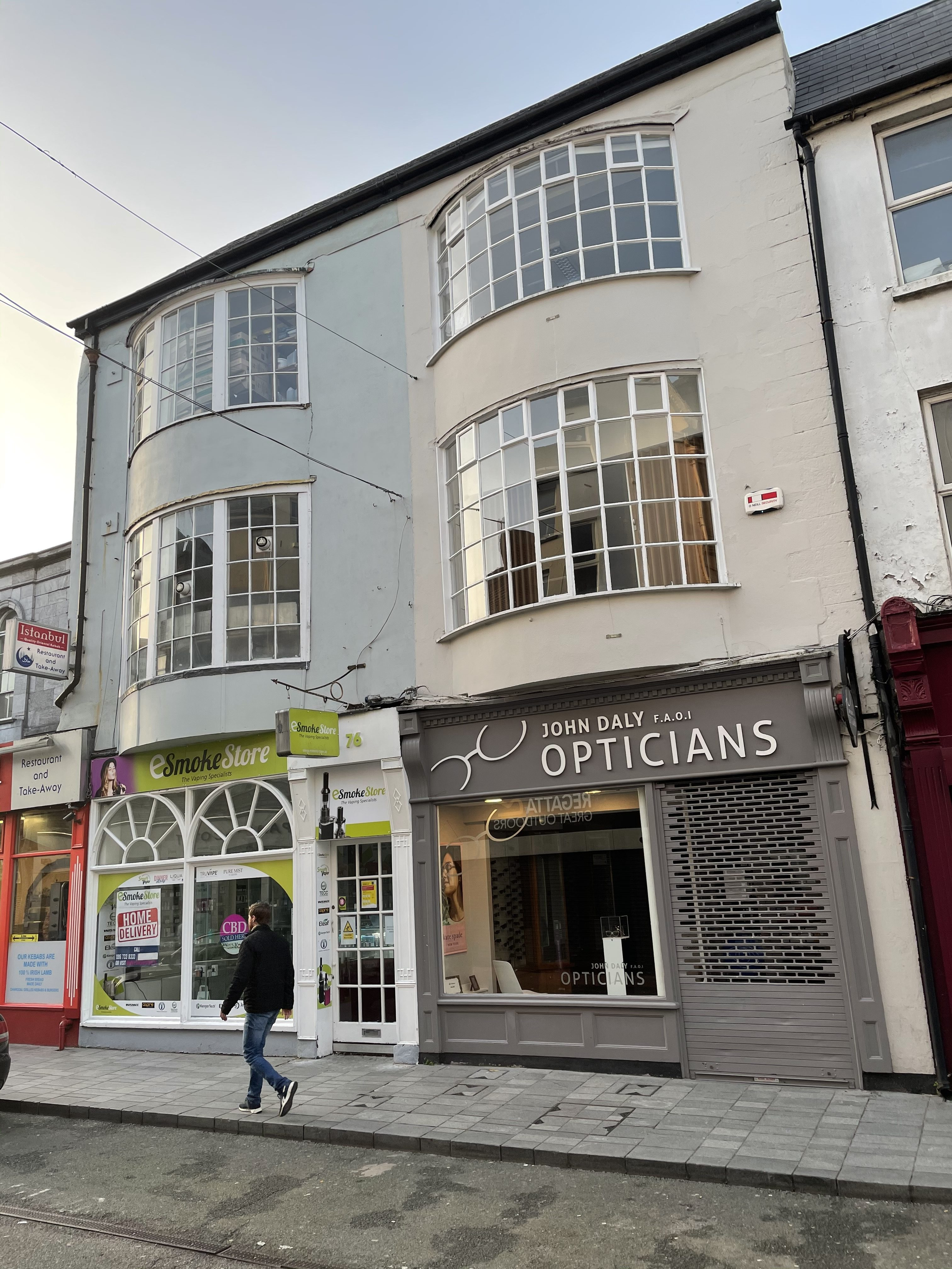 A pair of terraced single-bay three-storey houses, c. 1810, having a two-storey bowed oriel window, Oliver Plunkett Street, Cork, present day (picture: Kieran McCarthy)