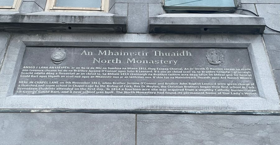 Commemorative plaque on exterior of North Cathedral wall showcasing early origins of North Monastery School (picture: KIeran McCarthy)
